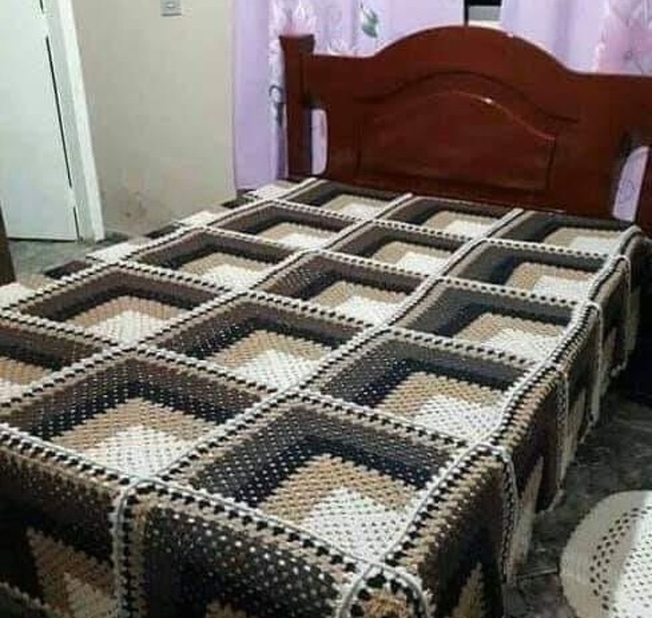 A bed with numerous sections or a checked bedsheet?