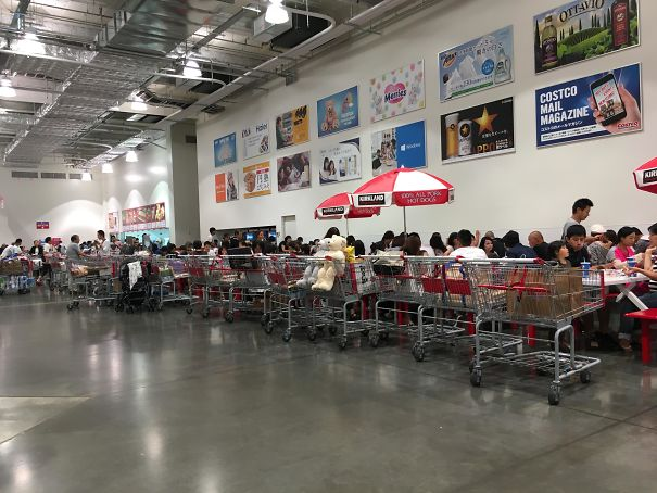 People in Japan lineup their carts in the Costco in the food court