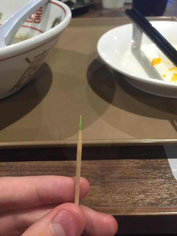 The tip of the toothpick is coated with mint
