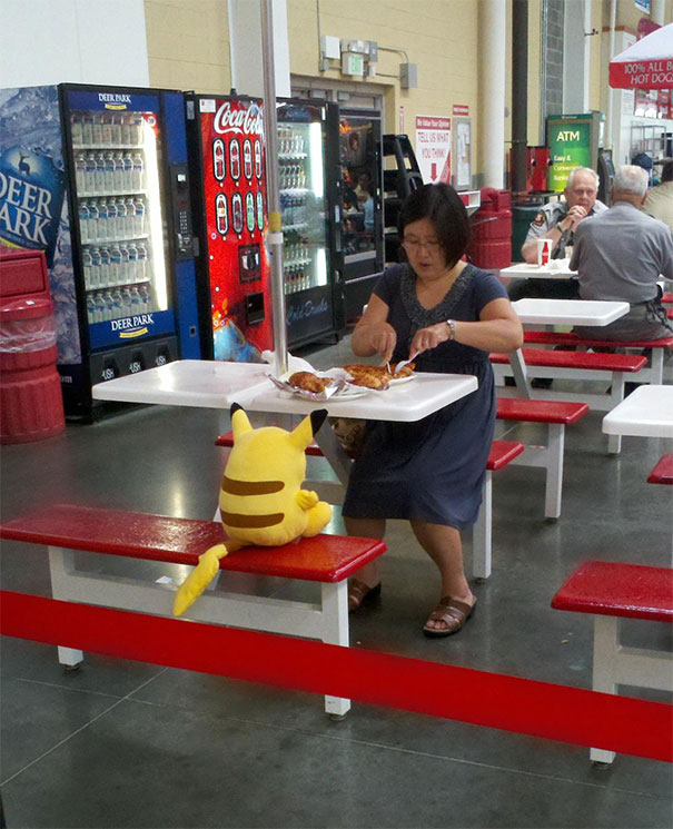 Costco lady enjoys the lunch date with Pikachu!