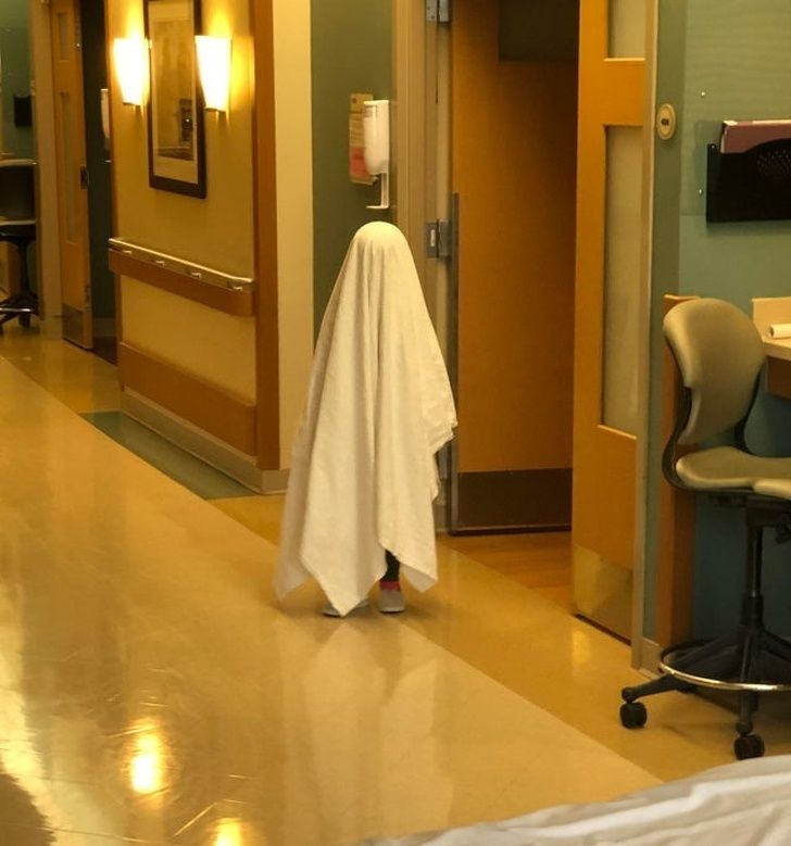 My daughter pretending to be a ghost at the hospital. Probably a poor choice