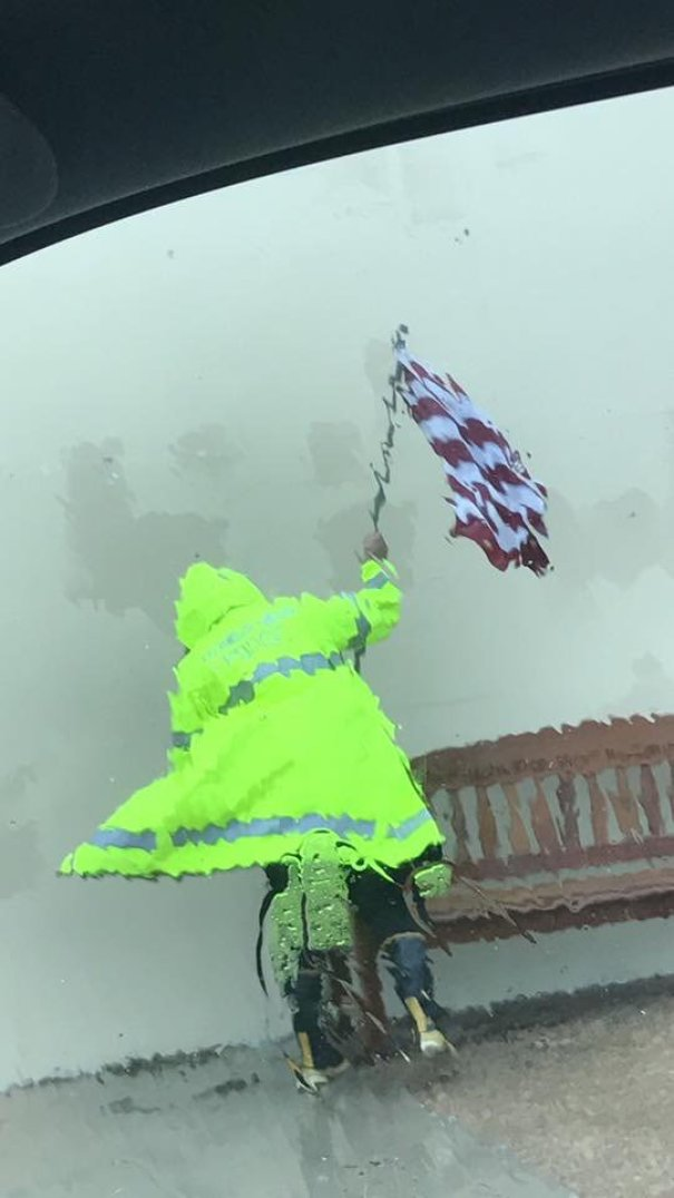 Police Officer Trying To Save American Flag During Hurricane Harvey Looks Like A Painting