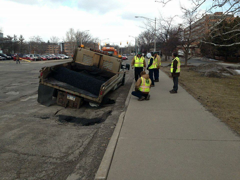 That awkward moment when a pothole takes out the repair truck