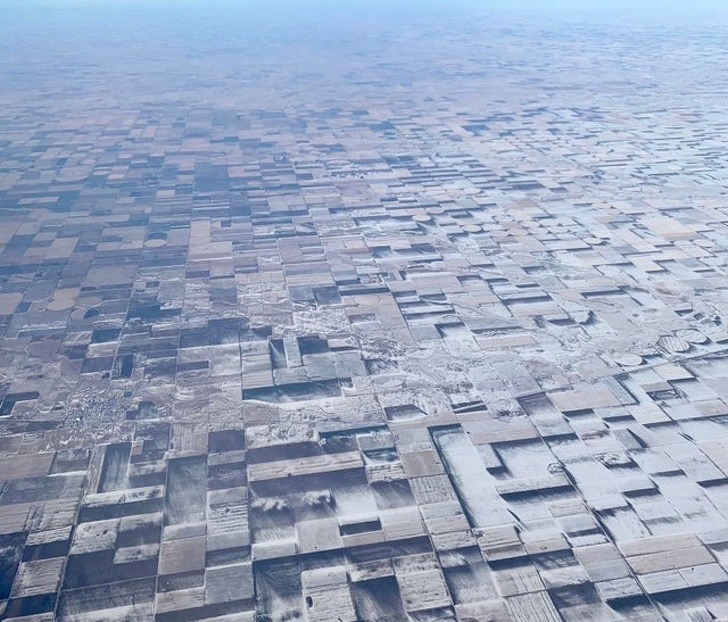 This flat farmland in eastern Colorado has snow patches that create a 3D illusion