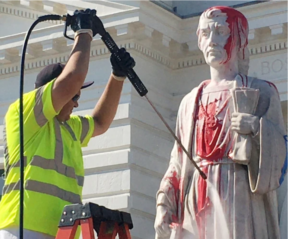 People protest to take down the statue of Christopher Columbus