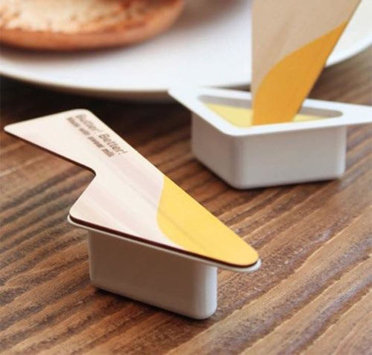 One of the best designs that show a tub of butter that even works as a knife