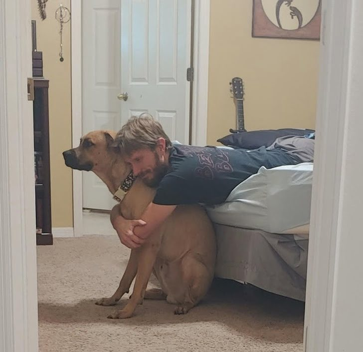 I caught him hugging the giant dog he didn't want. He was also singing the dog his own personal song